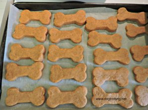 dog pumpkin and peanut butter cookies on tray