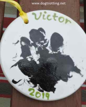 paw print on ceramic disc for dog rescue fundraiser