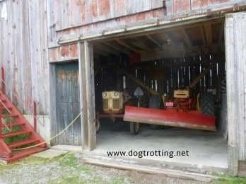 antique farm equipment in barn