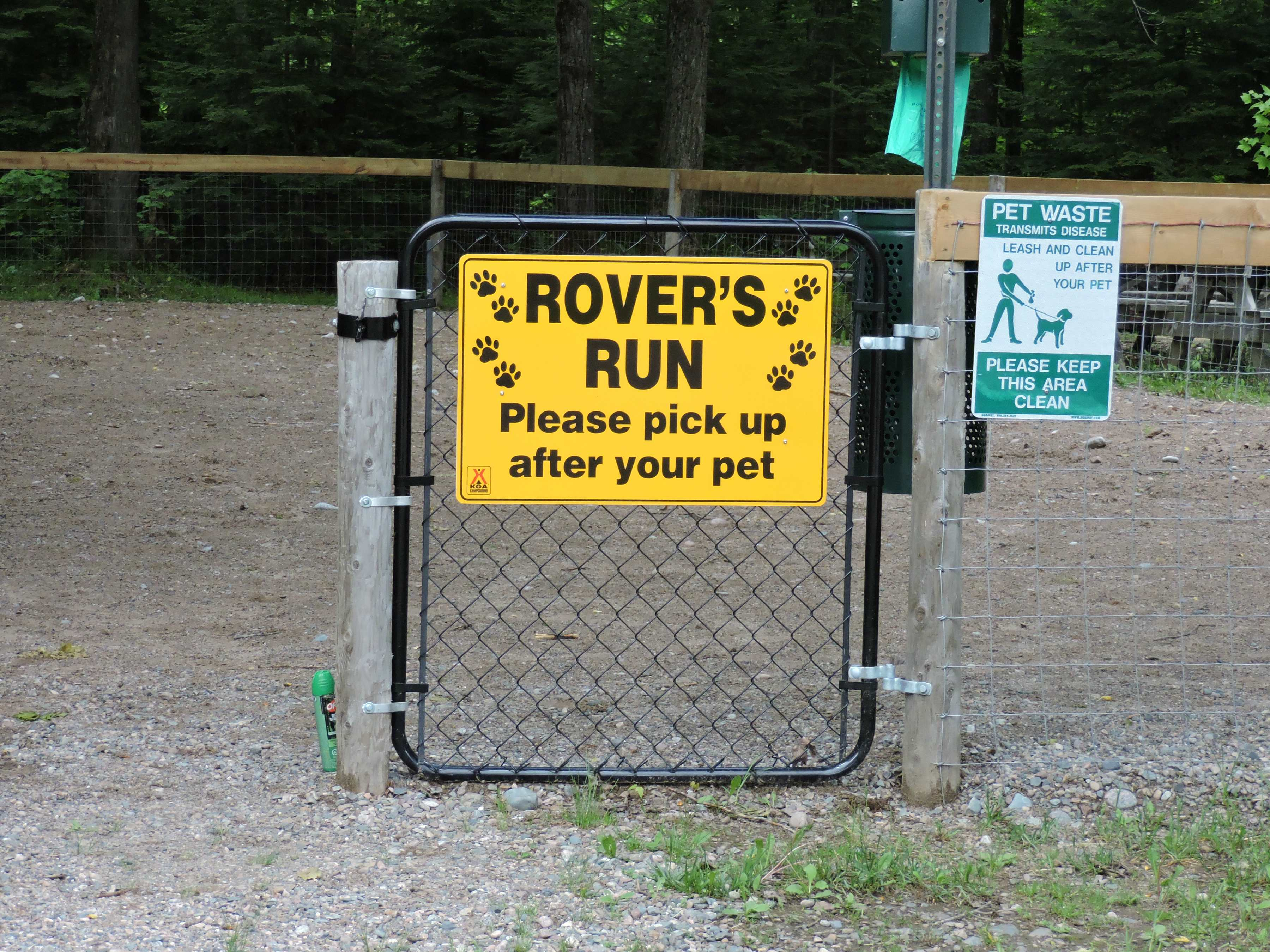 gate to Rover's Run dog run area at KOA Holiday dog-friendly campground in sault ste. Marie, Ontario