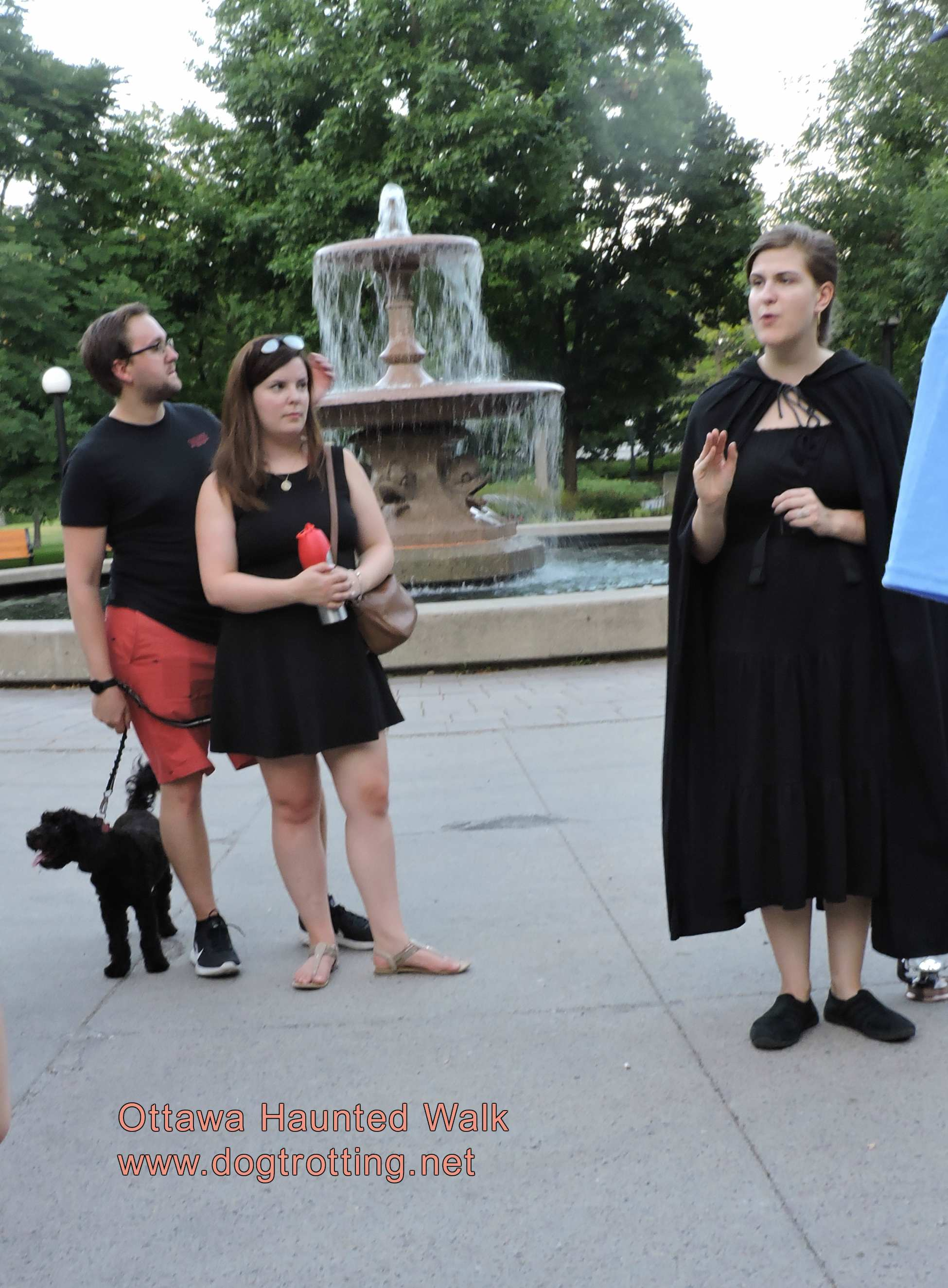 participants with dog and cloaked guide on Ottawa Haunted Walk